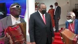 Uhuru Kenyatta Gifts Veteran Kikuyu Musician Wanganangu with Land, Hands Him Title Deed