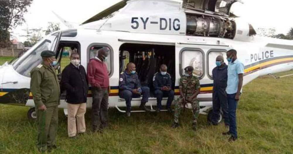 Mathira East Police Commander James Baraza (in jungle uniform) and the rescue team at Karatina Stadium on May 8, 2021. Photo: Nation.