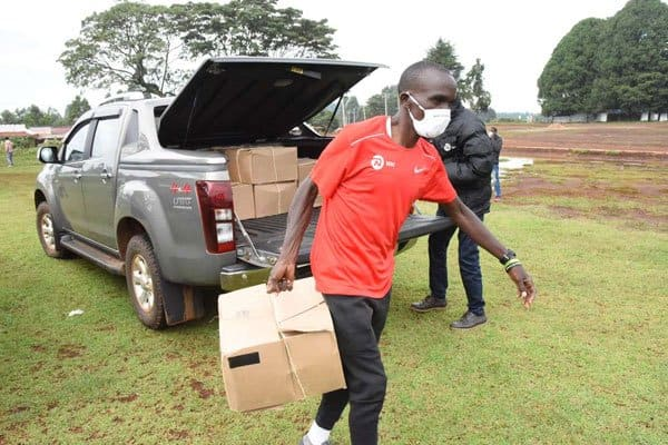Coronavirus: Kipchoge joins fight against pandemic as he helps deliver relief food