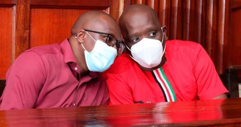 Dennis Itumbi (r) and Samuel Gateri Wanjiru at the Milimani Law Court on June 15, 2021. Photo: Nation.