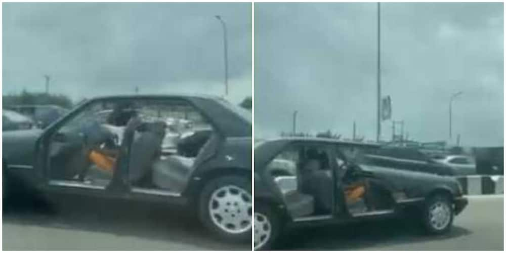 Two men were spotted driving a doorless car. Photo:@instablog9ja.