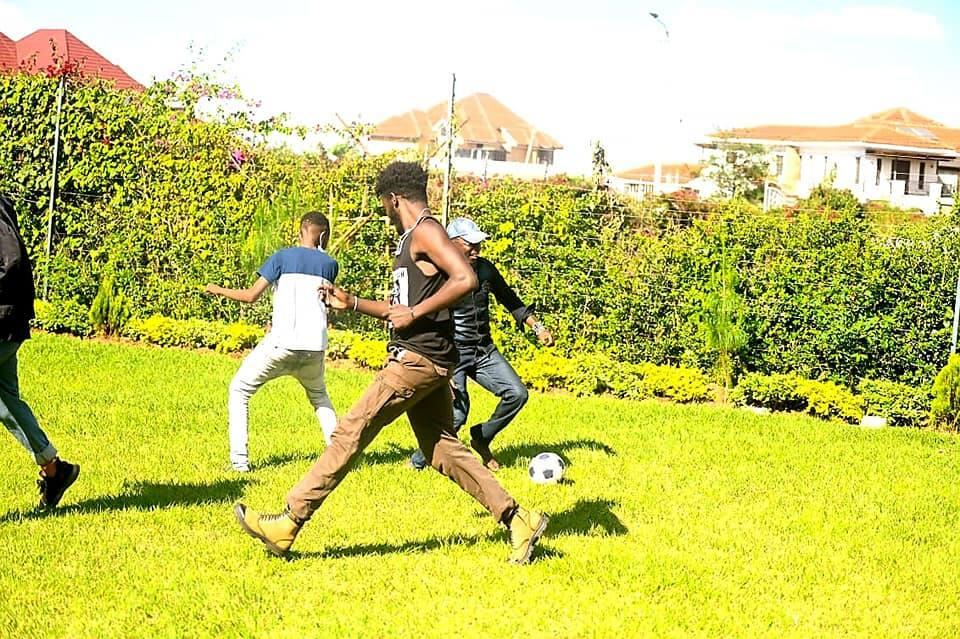 Ababu Namwamba playing football.