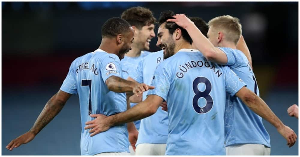 Man City players celebrating a goal during the 2020/21 season. Photo: Getty Images.