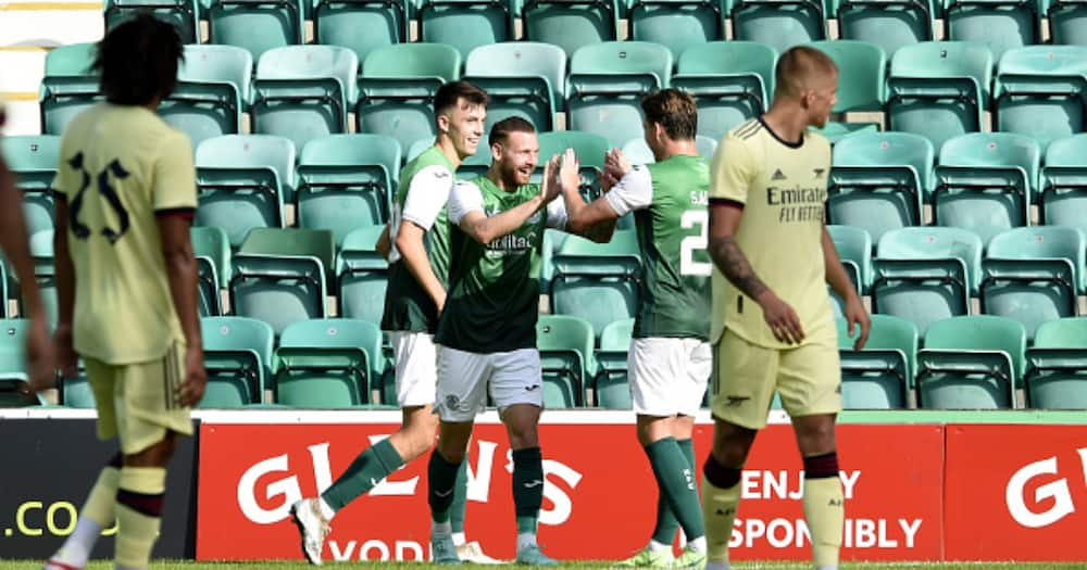 Hibernian players celebrate after scoring against Arsenal. Photo by Ian Rutherford.