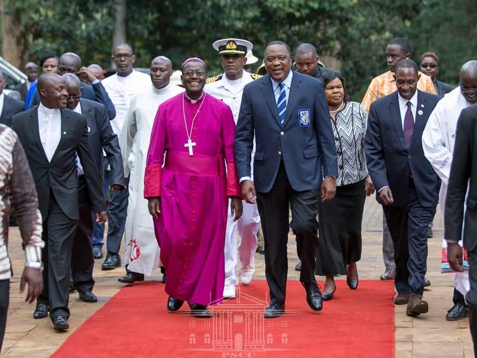 Uhuru arrives at his former high school dressed in uniform