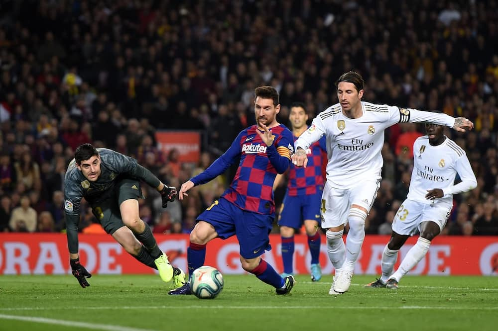 Sergio Ramos and Lionel Messi in action in Champions League. Photo by Alex Caparros.