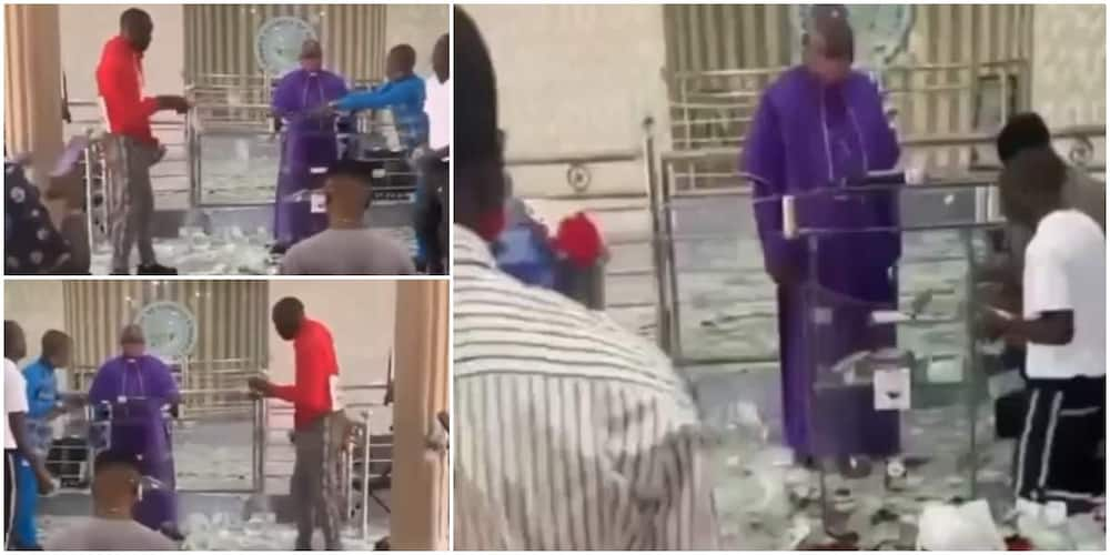 Reactions as young boys rain money on the altar, leaves priest confused in the video. @naijaloadedotng.