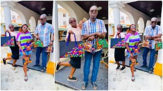 Young Lady Delighted after Her Parents Flaunt Ankara Bags She Designed