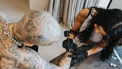 "Kourtney Kardashian Tattoos Lover Travis Barker's Arm: ""I Love You"""