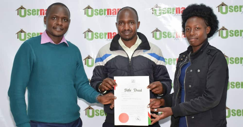 Property firm hands land title deed to needy man with blind, disabled son