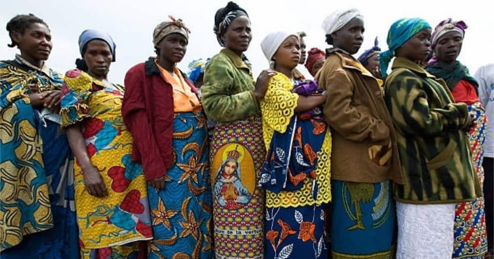 Pregnant women queue for birth kits from a local NGO at a camp for Internally Displaced People (IDPs) in Kibati, Goma.