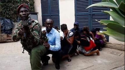 Kenyans sing praises of brave officer pictured protecting victims from gunfire