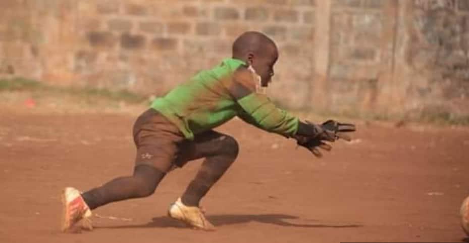 Kenyan football fans to help Mathare boy photographed saving ball wearing worn goalkeeper gloves