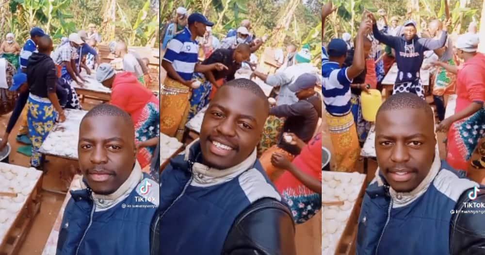Kenyan men dance while preparing chapatis.
