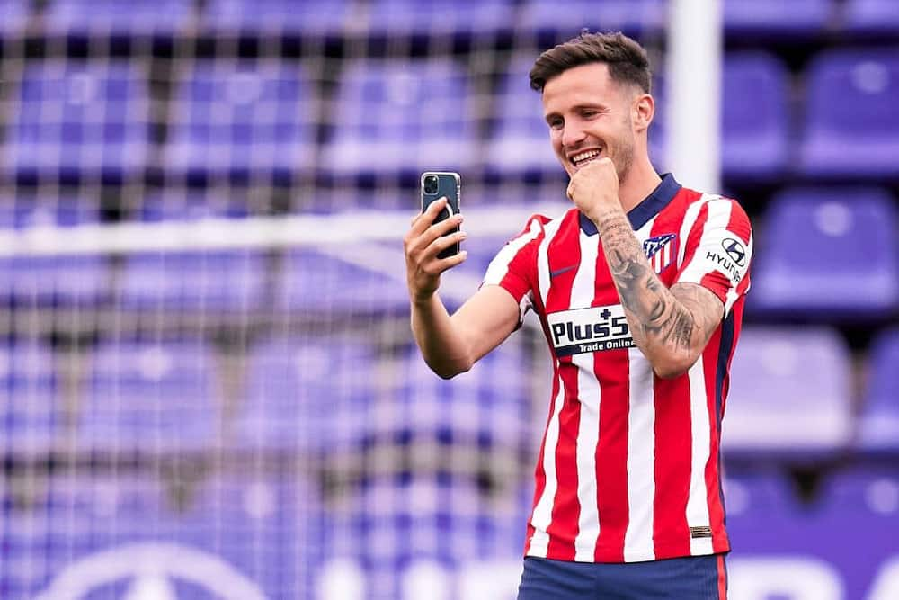 Saul Niguez calling his family after winning the Spanish League title with Atletico Madrid last season. Photo by Pedro Salado/Quality Sport Images.