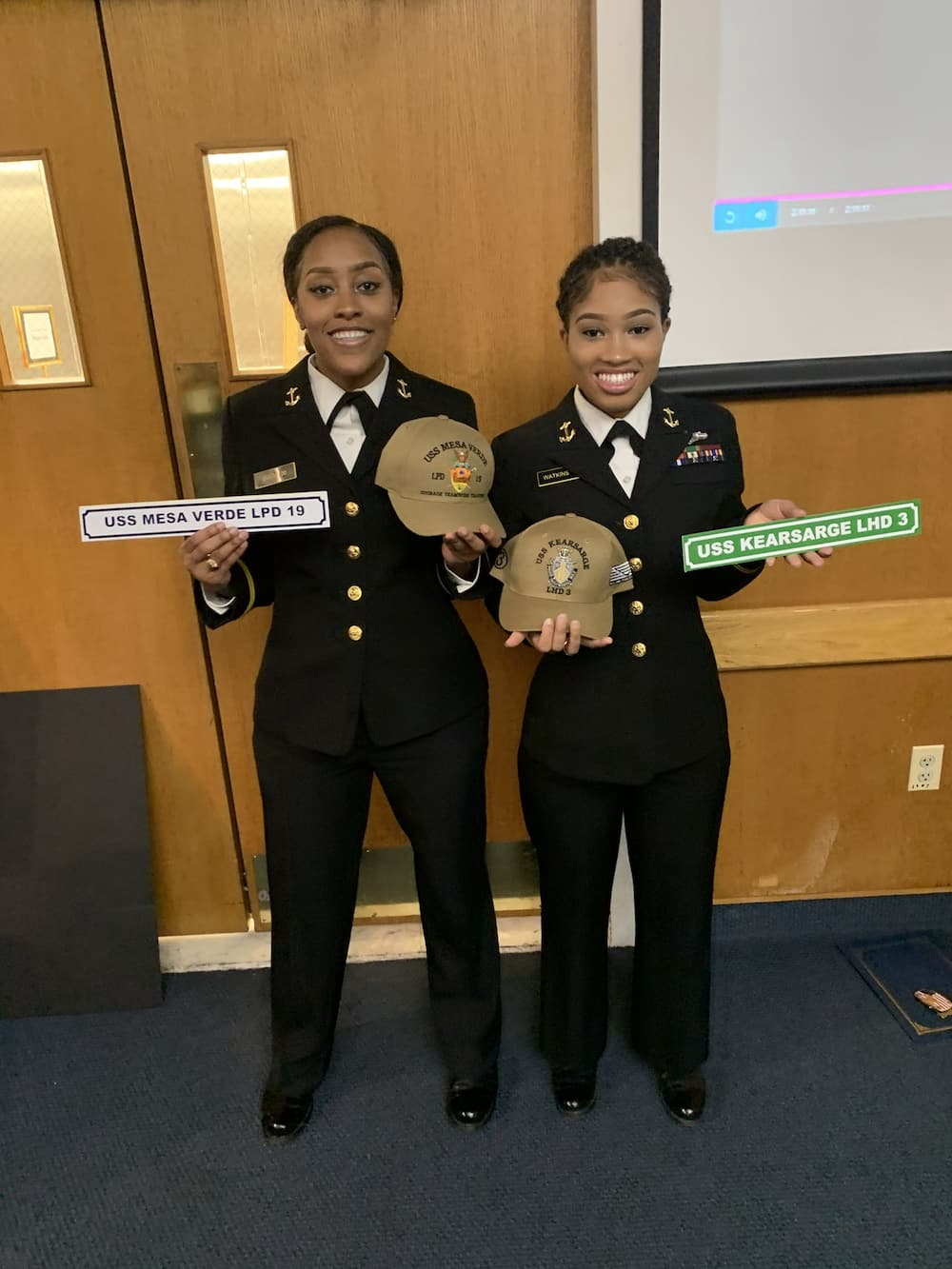 Young black lady celebrates as she graduates from US Naval Academy