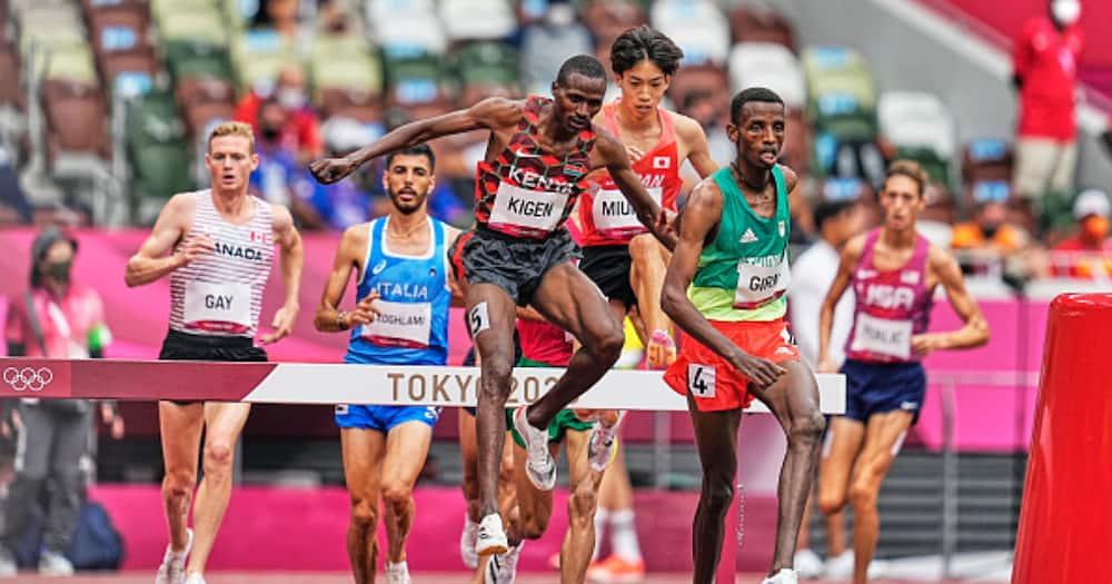 Benjamin Kigen from Kenya and Lamecha Girma from Ethiopia during 3000 meter steeplechase for men at the Tokyo Olympics. Photo by Ulrik Pedersen/NurPhoto via Getty Images.