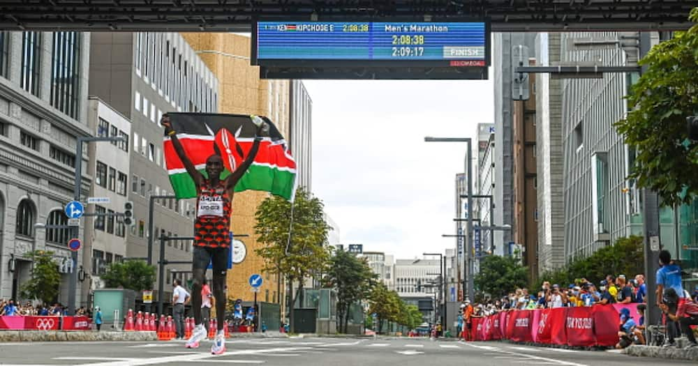 Eliud Kipchoge of Kenya celebrates after winning the men's marathon at Sapporo Odori Park during the 2020 Tokyo Summer Olympic Games. (Photo By Ramsey Cardy/Sportsfile via Getty Images)