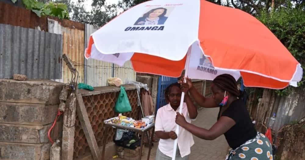 Millicent Omanga: Netizens blast senator for donating umbrella to hawker with her portrait on it