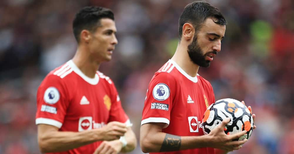 Bruno Fernandes prepares to take his penalty against Aston Villa as Cristiano Ronaldo looks on. (Photo by Simon Stacpoole/Offside/Offside via Getty Images)