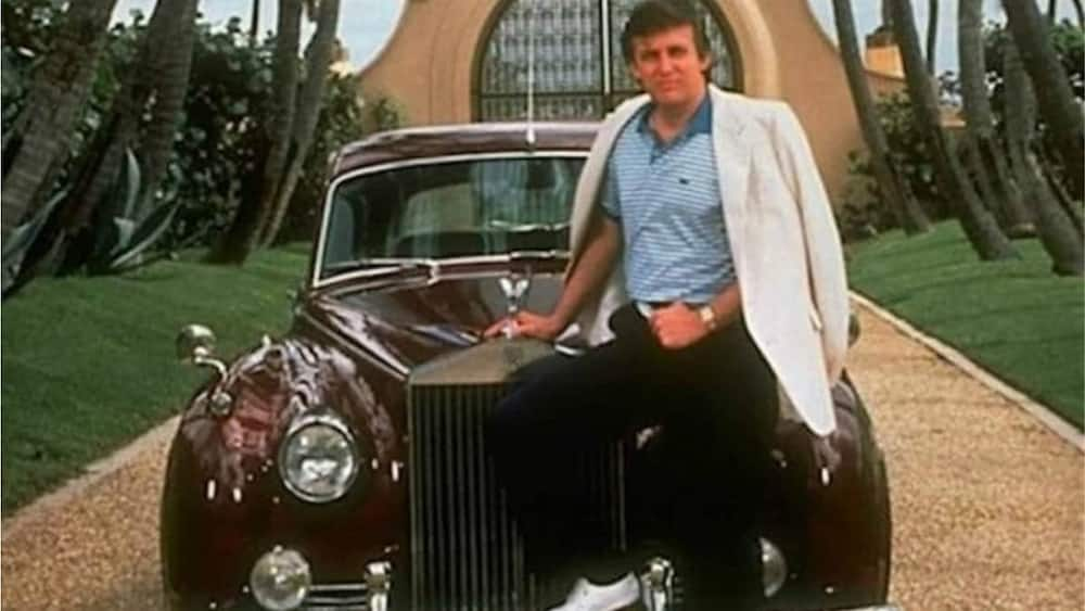 Donald Trump poses with his car. Photo source: Insider