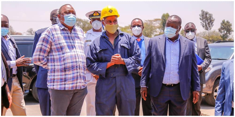 President Uhuru Kenyatta, Interior SC Fred Matingi together with the artisan at the workshop. Photo: Ministry of Interior.