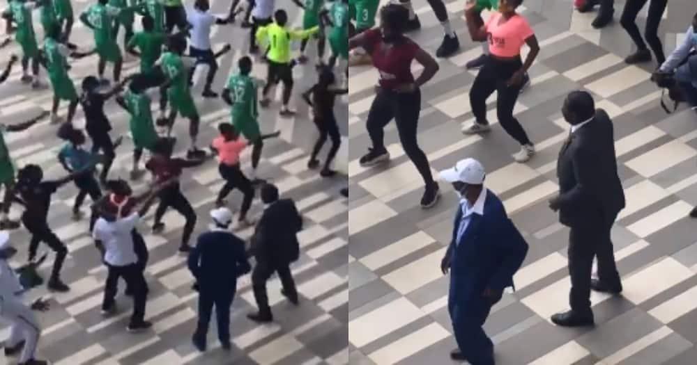 Raila Odinga energetically dances with Chris Kirubi in front of large crowd