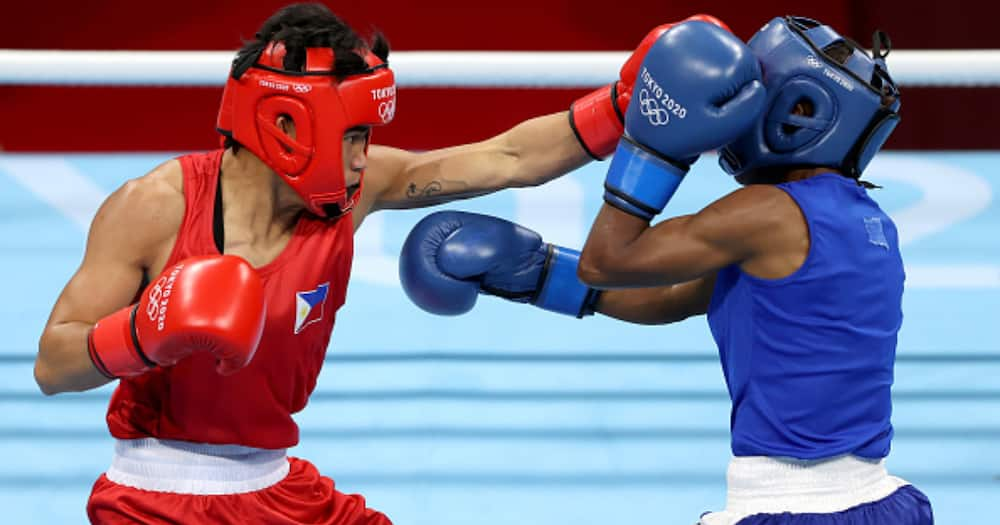 Irish Magno of Philippines exchanges punches with Christine Ongare of Kenya during the Women's Fly (48-51kg) at Kokugikan Arena on July 25, 2021, in Tokyo, Japan. (Photo by James Chance/Getty Images)