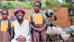 Teacher gives new motorbike, uniforms, other items to 2 girls in a village to start school