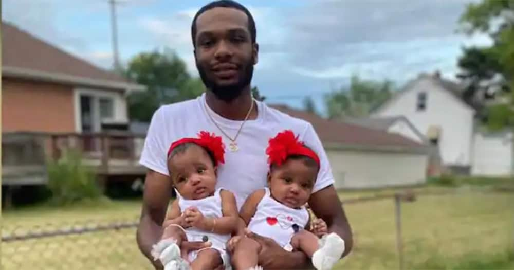 Ray Lucas with his twin daughters.