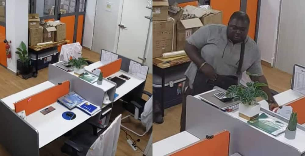 Man stealing laptops from the office