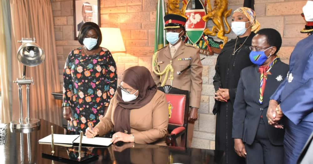 President Samia Suluhu Hassan signing a visitor's book after arriving in Nairobi for a two-day State Visit to Kenya. Photo: State House Kenya.