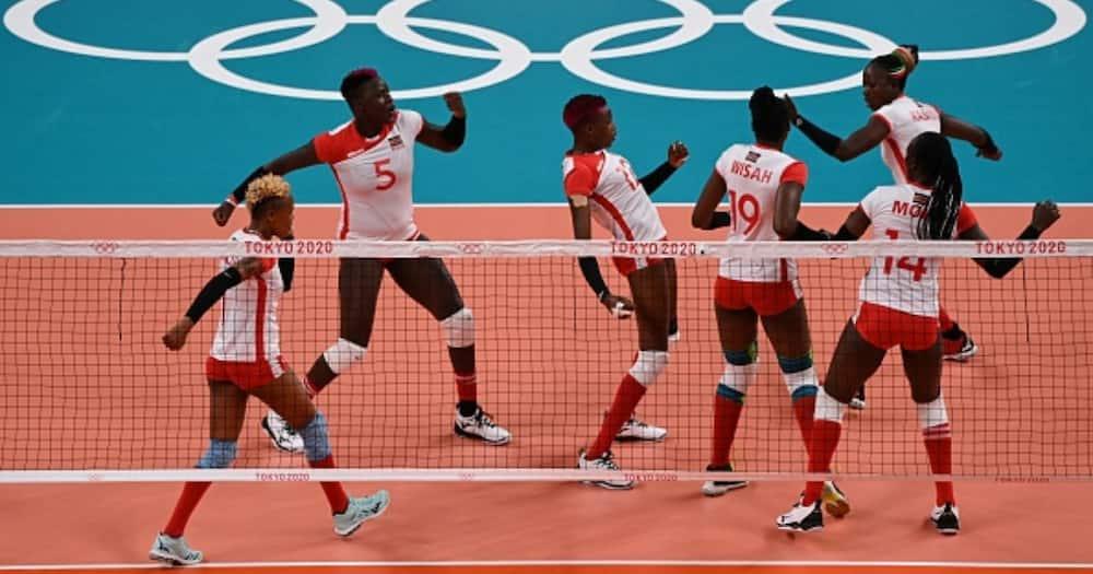 Kenya's players react after a point in the women's preliminary round pool A volleyball match between Japan and Kenya during the Tokyo 2020 Olympic Games at Ariake Arena in Tokyo on July 25, 2021. (Photo by YURI CORTEZ / AFP).