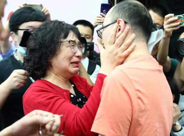 Tearful moment as man stolen as a child reunites with mother 32 years later