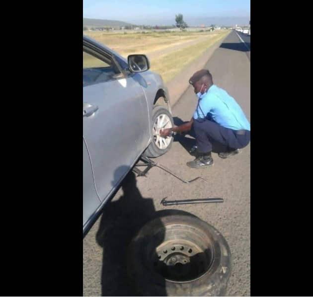 Kenyans praise policeman who helped stranded priest change flat tire on highway