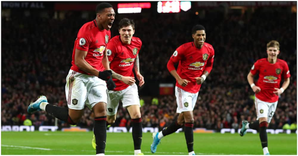 Man United players celebrating a goal - Getty Images.