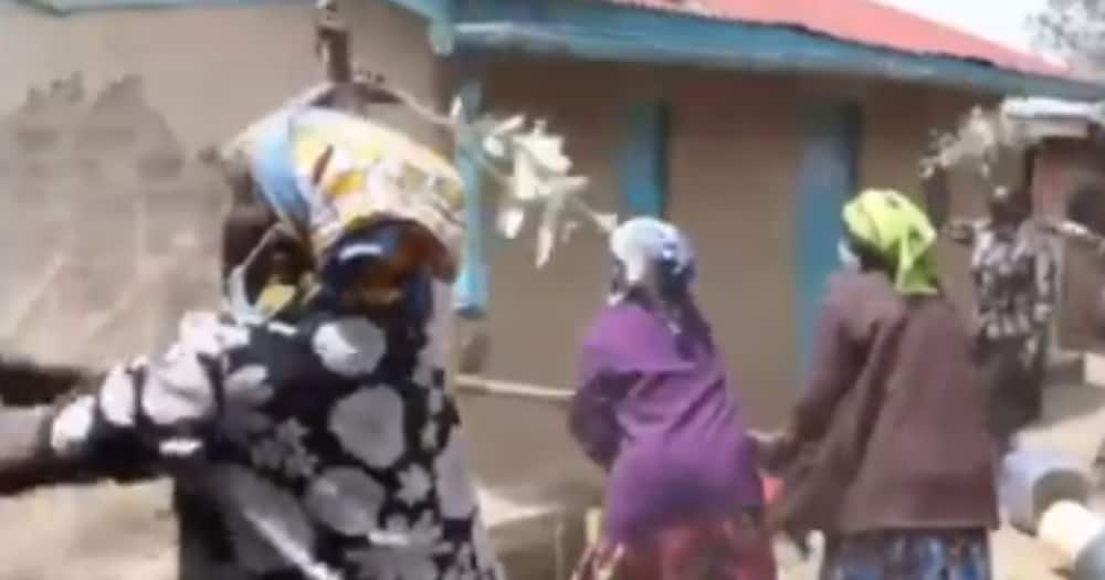 Women demolishing Esther Kipchumba's house. Photo: Screenshots/Baringo News.
