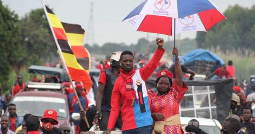 Bobi Wine's supporters swim through swamp to attend rally after police blocked road