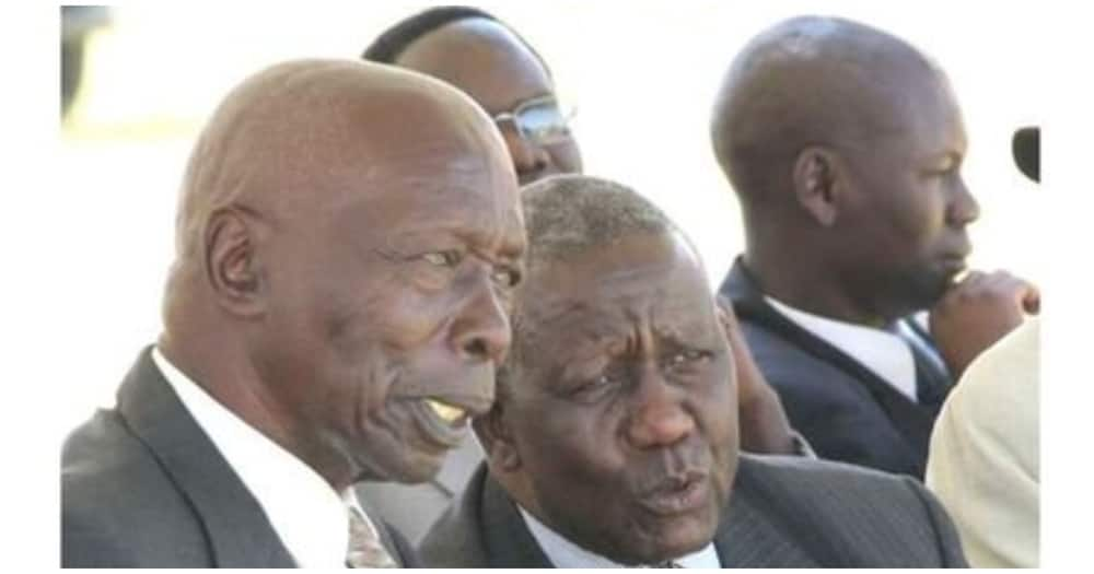 Retired President Daniel Moi with former State House Comptroller Abraham Kiptanui during a function at Tembelio Secondary School in Eldoret East Constituency. Photo: Nation.
