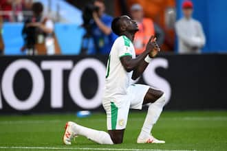 Liverpool star Sadio Mane breaks down in tears as fans boo him after missing a sitter in the AFCON
