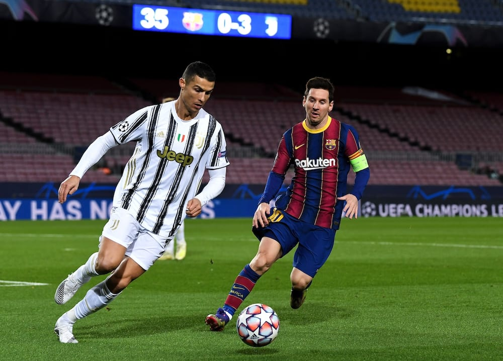 Messi and Ronaldo in action.
