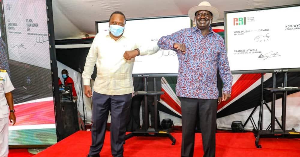 President Uhuru Kenyatta (l) and former PM Raila Odinga led Kenyans in the collection of signatures for the BBI process at KICC. Photo: Raila Odinga