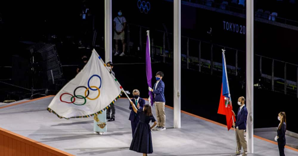 Closing ceremony at the Olympic Stadium. The Mayor of Paris, the next venue of the Olympic Games, Anne Hidalgo, waves the Olympic flag. (Photo by Ayman Aref/NurPhoto via Getty Images)