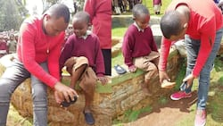 Muthee Kiengei Gifts Less Fortunate Kid Brand New Shoes during Visit to School