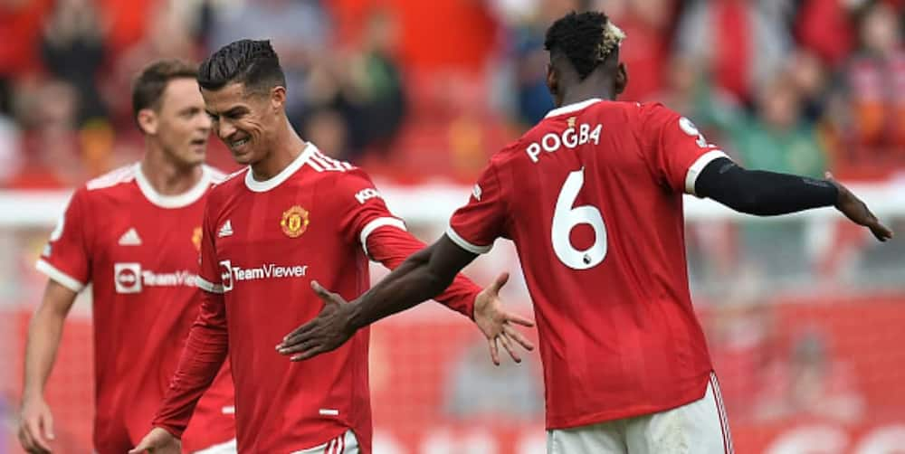 Pogba and Ronaldo during Man United's EPL clash with Newcastle. Photo by OLI SCARFF.