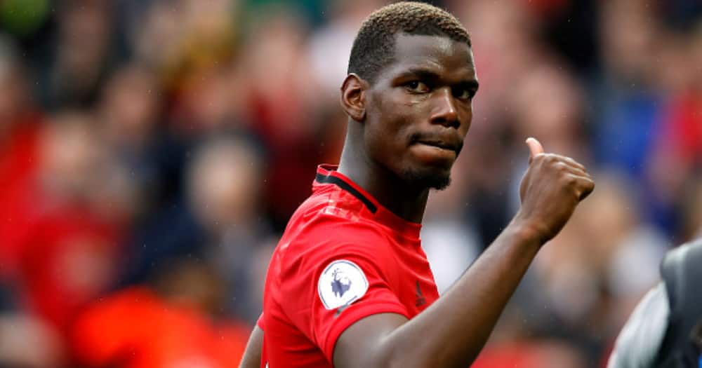 Pogba while in action for Man United. Photo by Martin Rickett.
