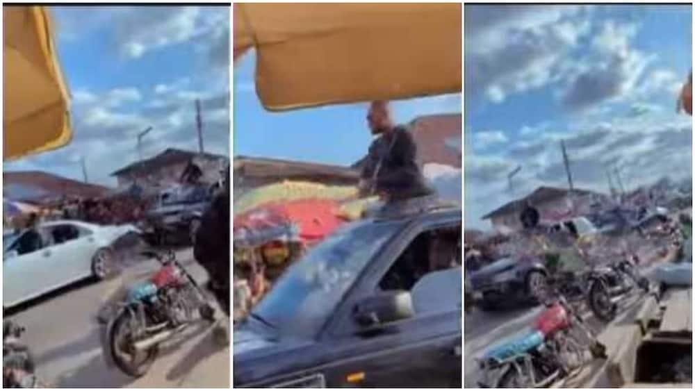 An okada man left his bike to pick money.