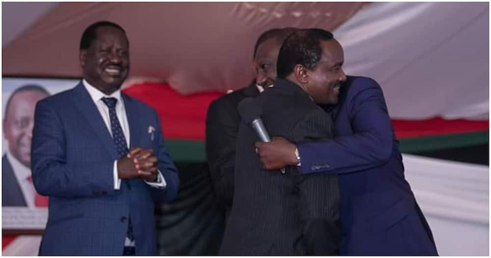 Deputy President William Ruto and Wiper leader Kalonzo Muskoya embrace each other as Raila Odinga looks. Photo: Dennis Itumbi.
