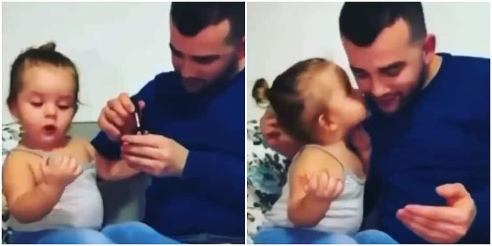 Cute Moment Little Girl Pecked her Dad after he Painted her Nails, Their Video Make Many Emotional