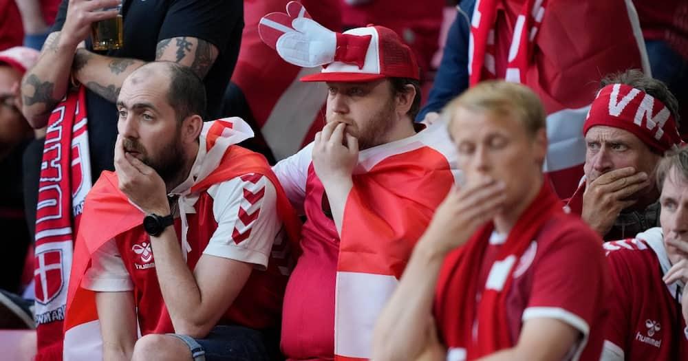 Fans pray for Eriksen during Denmark vs Finland